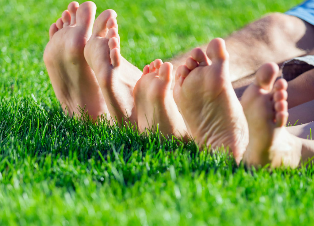 feet on natural grass